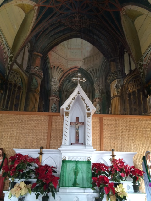 Altar at Painted Church. The apparently extended space behind is a mural.