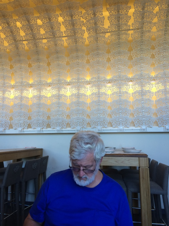 The lacy decoration behind Tom is composed of oversized white Spanish combs that completely covered the ceiling of the restaurant where we ate lunch.