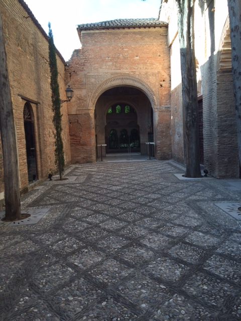 Cool archway in the parador. The paving is made of different colored pebbles in intricate patterns.