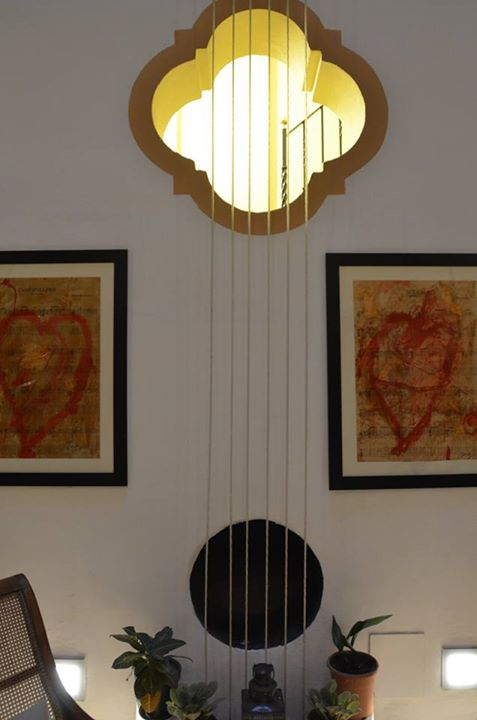 "The living room at the Casa de Maestro has this depiction (sculpture?) resembling the strings and sound hole of a guitar. The ""strings"" reach from the four-story ceiling to the floor."