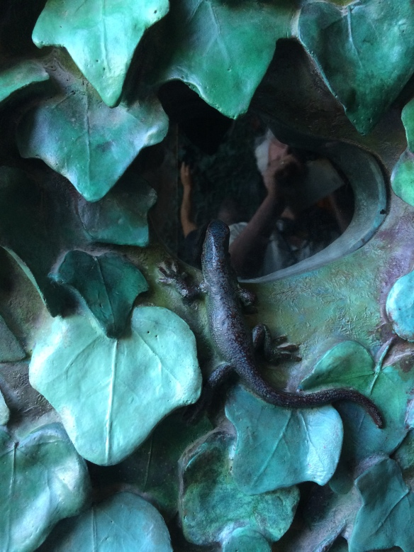 This little lizard is one of many creatures peering out from the bronze leaves that completely cover the main door