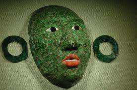 The oldest jade mask found at Calakmul, using tiny jade pieces to create the contours of the face.