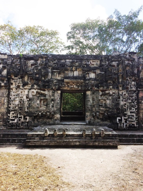 The entrance to the Jaguar Palace. The stones sticking up in front are its teetch, and you can see stylized eyes and ears to either side of the doorway.